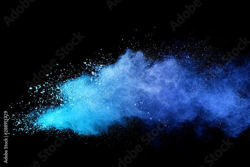 Blue sky color powder explosion on black background.