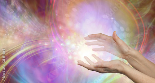 Valokuvatapetti Sending you beautiful healing energy vibes - female cupped hands with white ener