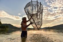 Fishermen Fishing In The Early...