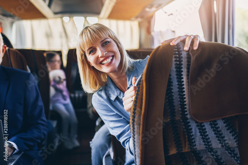 Happy passengers traveling by bus. Canvas