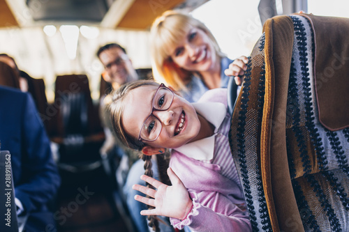 Happy passengers traveling by bus. Wallpaper Mural