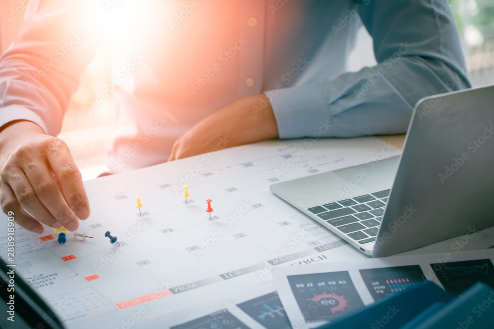 Fototapeta Business Man with laptop, Calendar in office, Business management event . Organizational management, business plan targeted marketing activities, media relations advertising.