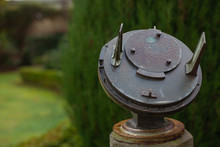 Close-up Vintage Ancient Metal Rusty Sundial In The Garden