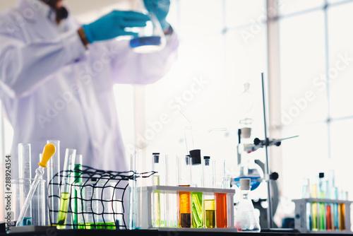 Fotografia  Test tubes with colorful liquid in laboratory
