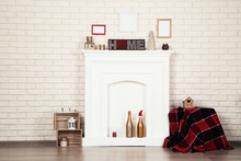 White Fireplace With Photo Fra...