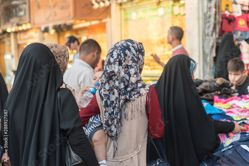 Baghdad, Iraq – July 6, 2019: Arabic women on street buying clothes Tablou Canvas