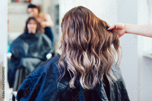 Obraz Beautiful hairstyle of young woman after dying hair and making highlights in hair salon. - fototapety do salonu
