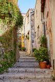 Fototapeta Perspektywa 3d - Sainte Agnes village steps in Provence, France