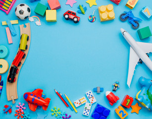 Frame of kids toys on blue background