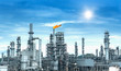 canvas print picture - Oil and gas industrial refinery zone,Detail of equipment oil pipeline steel with valve from large oil storage tank at twilight.