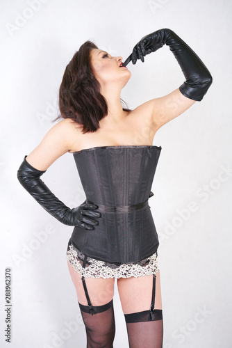 pretty woman with black long spandex gloves on white studio background Canvas Print