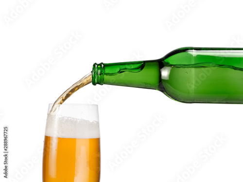 Fotografie, Obraz  Beer pouring in a glass from green bottle