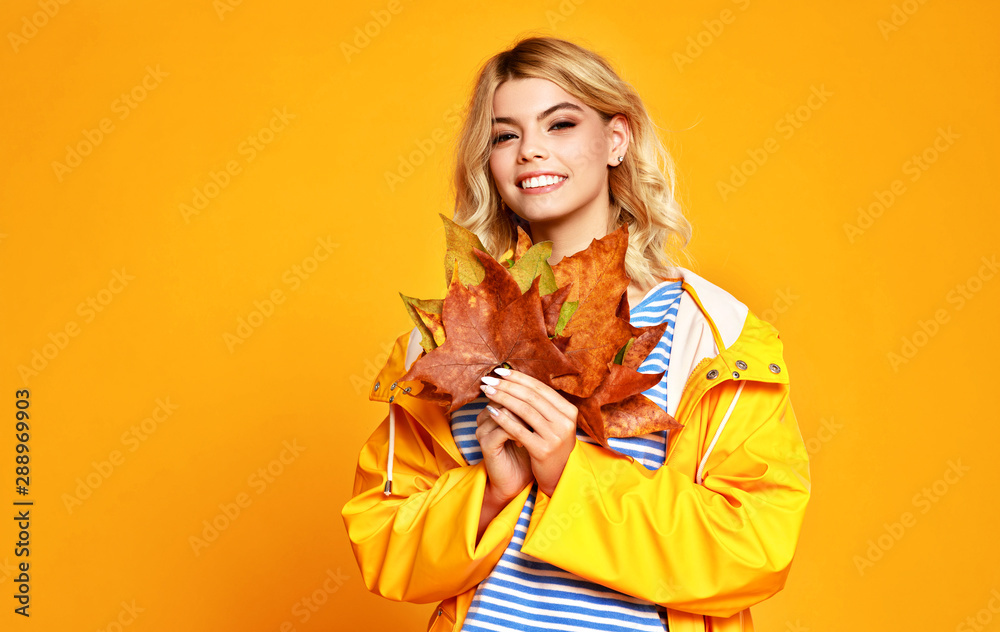 Fototapety, obrazy: happy emotional girl with autumn leaves on colored yellow background