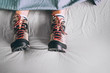 Leinwanddruck Bild - All time ready for trekking. Hiker sleeping in comfort trekking boots. Footwear on the bed sheet background concept image.