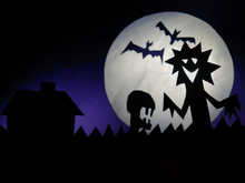 Dark Halloween Season Background With Moon In The Background And Scary Creatures Silhouettes. Alien Scull, Bats, And Funny Monster.