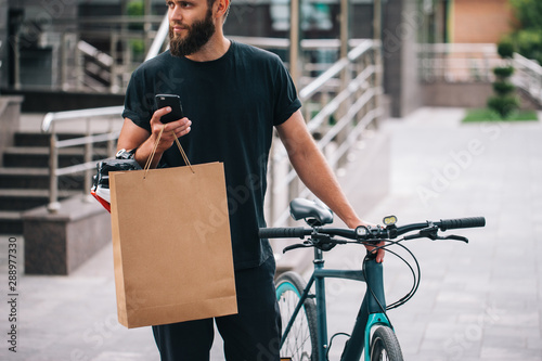 Bearded male courier with bicycle delivery food service at home Tablou Canvas