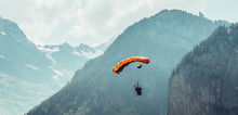 Basejumper Landing In The Lauterbrunnen Valley
