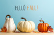 canvas print picture - Hello fall message with pumpkins on a blue background