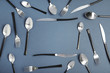 canvas print picture - Frame made of steel cutlery on grey background, top view. Space for text