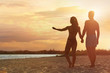Young woman in bikini spending time with her boyfriend on beach. Lovely couple