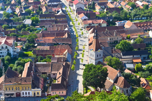 Cadres-photo bureau Europe de l Est Bird's eye view of street, traditional houses, churches and clock tower in a Romanian mountain town in Transylvania. Rasnov, Brasov county, Romania
