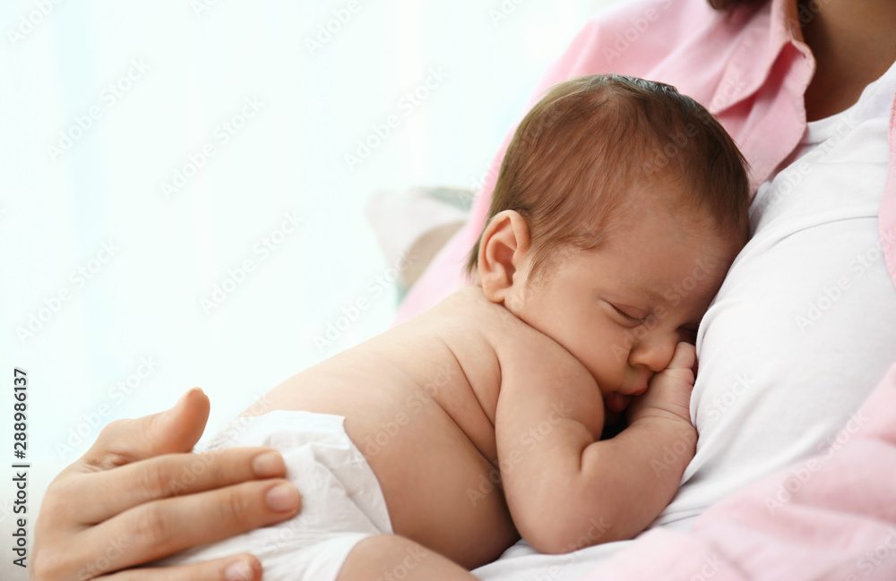 Fototapety, obrazy: Young mother with her little baby on light background