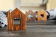 Leinwandbild Motiv Wooden house model and scarf on grey table, space for text. Heating efficiency