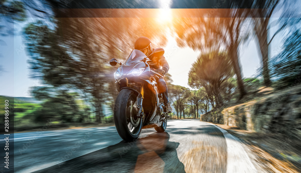 Fototapeta motorbike on the coastal road riding. having fun driving the empty highway on a motorcycle tour journey