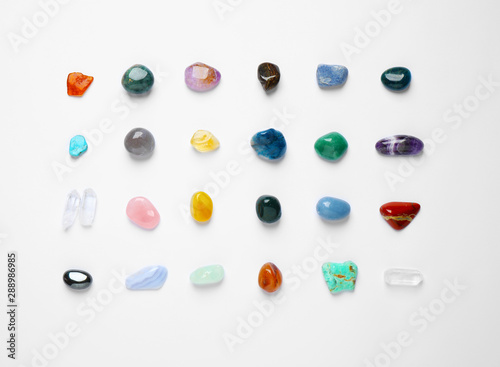 Different gemstones on white background, top view
