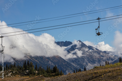 Chair lift with Mountain