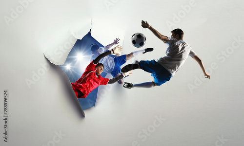 Cuadros en Lienzo  Paper breakthrough hole effect and soccer