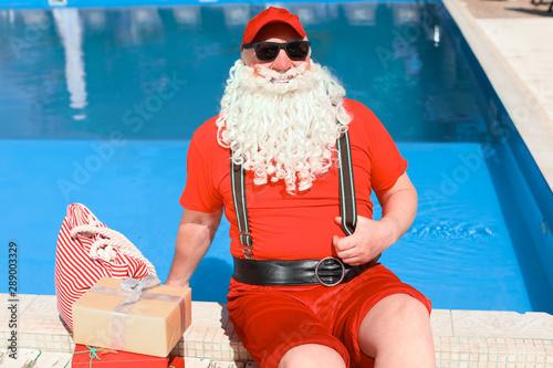 Santa Claus with gifts near swimming pool at resort - Buy ...