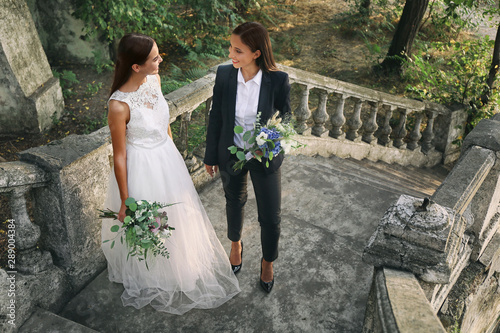 Beautiful lesbian couple on their wedding day outdoors Wallpaper Mural