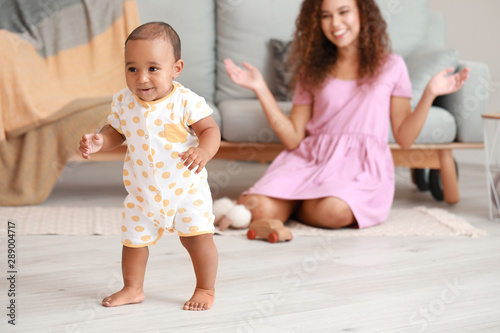 Obraz Cute little baby learning to walk at home - fototapety do salonu