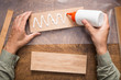 canvas print picture - Gluing wooden board