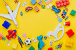 canvas print picture - Frame of kids toys on yellow background