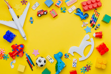 Frame Of Kids Toys On Yellow Background
