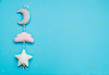 Baby Toys Moon, Cloud And Star On Blue Background With Copyspace
