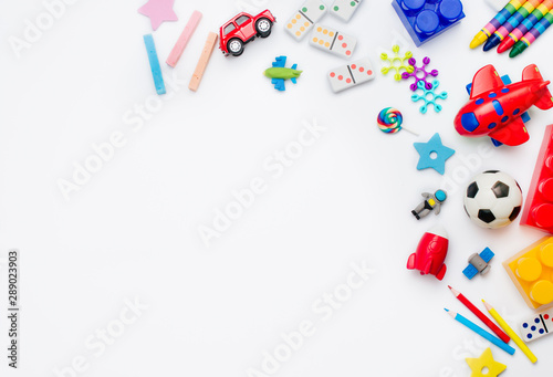 Foto Frame of kids toys on white background with copy space