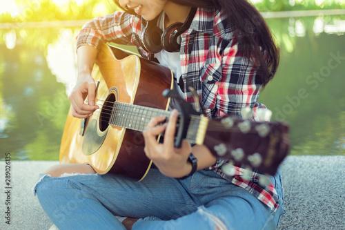 Vászonkép  Close up hand asian girl play acoustic guitar