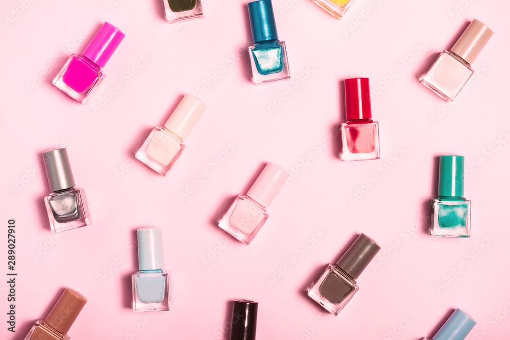 Fototapety, obrazy: Colorful Nail polish bottles pattern background. Close up.