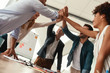 canvas print picture - We did it Business people giving each other high-five and smiling while working together in the modern office