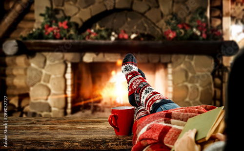 Garden Poster India Woman legs with christmas socks and fireplace