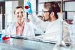Leinwanddruck Bild Analytical Chemists working in the lab