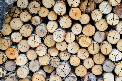 wall firewood - stacked of firewood prepare for the fireplace, barbecue, Background and texture