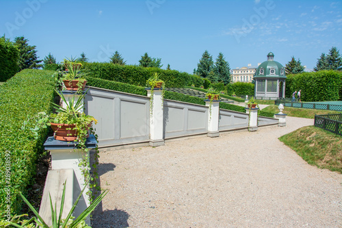 Wall Murals Old building Enjoyable garden wall and shed next to gravel walkway in sunny summer
