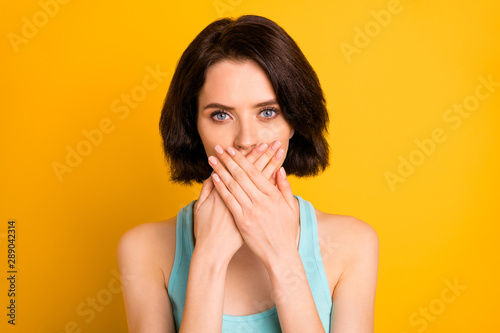 Photo of charming beautiful attractive girl covering her mouth with two hands wh Wallpaper Mural