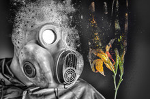 Man In The Gas Mask Holding A Burning Flower. Radiation Influence. Environmental Pollution. Chernobyl Concept. Dangerous Nuclear Power.