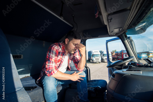 Pinturas sobre lienzo  Truck driver sitting in his truck cabin feeling worried and upset