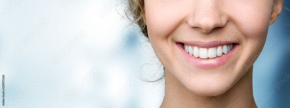 Fototapeta Beautiful wide smile of young fresh woman with great healthy white teeth. Isolated over background